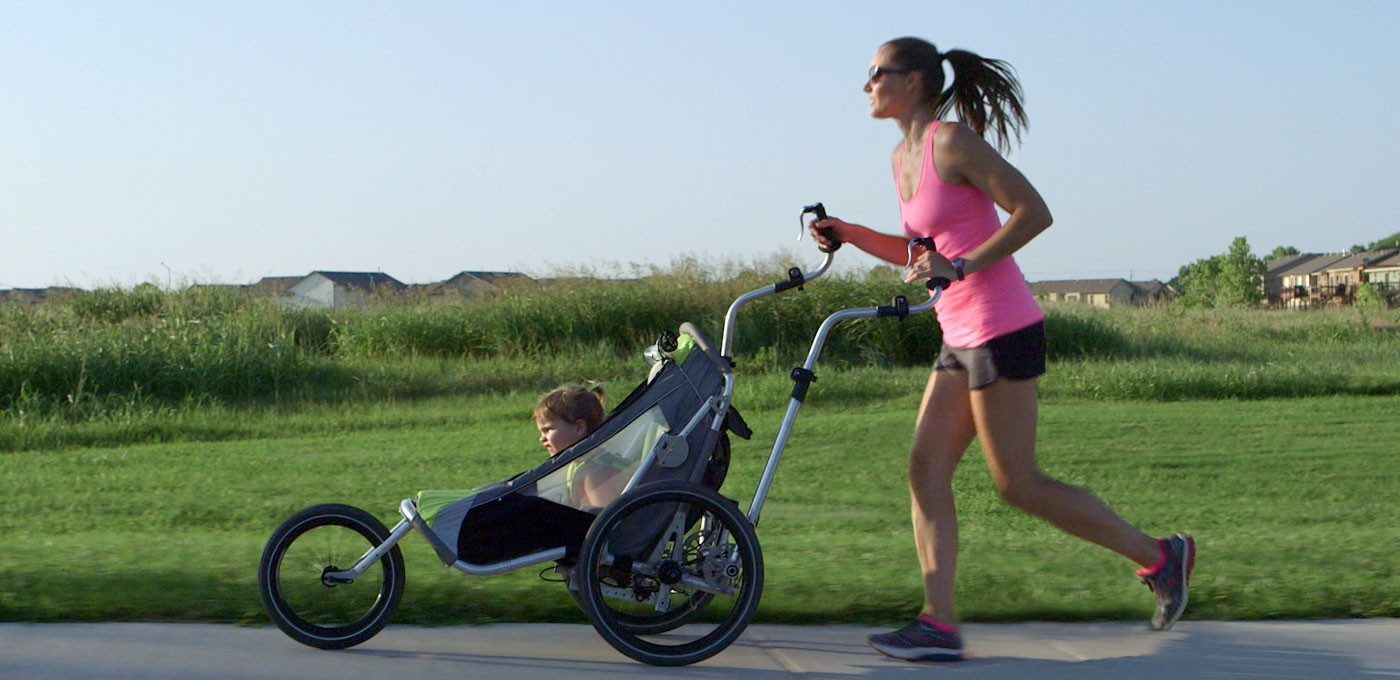 Woman running with a Jogalong Jogging Stroller